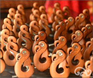 Double twists and matau carvings in a stand for corporate customer