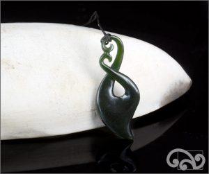 Dark greenstone twist pendant