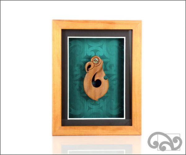 Framed fishhook carving
