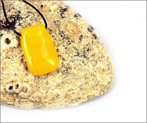 Yellow dichroic glass pendant.