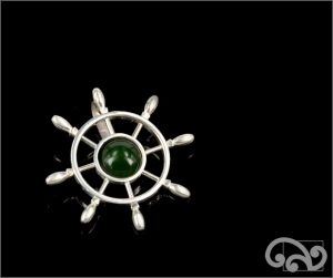 Silver steering wheel with greenstone centre