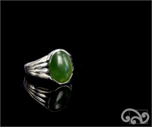 Silver ring with large oval greenstone